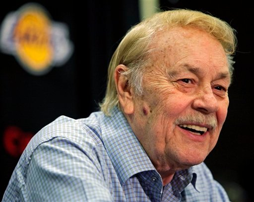 © In this Aug. 17, 2010, file photo, Los Angeles Lakers owner Jerry Buss smiles during an NBA basketball news conference in Bell Gardens, Calif. Buss, the Lakers' playboy owner who shepherded the NBA franchise to 10 championships, has died in Los Angeles.