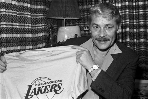 © In this June 18, 1981 file photo, Jerry Buss holds a Los Angeles Lakers shirt in Los Angeles. Buss died Monday, Feb. 18, 2013.