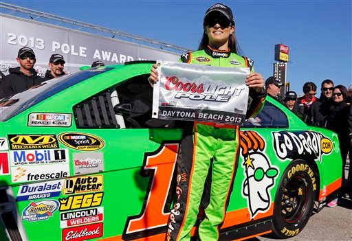 Danica Patrick displays the flag after winning the pole during qualifying for the NASCAR Daytona 500 Sprint Cup Series auto race at Daytona International Speedway, Sunday, Feb. 17, 2013, in Daytona Beach, Fla. (AP)
