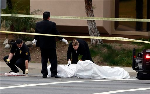 © Orange County coroner's officials remove a body from the scene in Orange, Calif., Tuesday, Feb. 19, 2013.