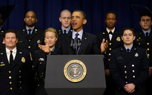 © President Barack Obama, accompanied by emergency responders, a group of workers the White House says could be affected if state and local governments lose federal money as a result of budget cuts, gestures as he speaks in the South Court Auditorium.