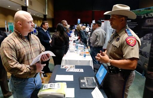 © Job Seeker Brett Culver, left, of Newalla, Okla., formerly of the Air Force, talks with Texas state trooper Deon Cockrell, right, at a Recruit Military job fair in Oklahoma City, Thursday, Jan. 31, 2013.