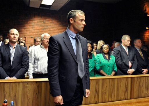© lympian Oscar Pistorius stands following his bail hearing in Pretoria, South Africa, Tuesday, Feb. 19, 2013.