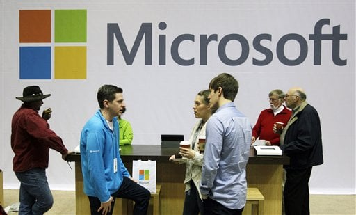 ILE - In this Nov. 28, 2012, file photo, Microsoft Corp. retail store employees and guests mingle at a pop-up Microsoft Store during Microsoft's annual meeting of shareholders, in Bellevue, Wash. (AP)