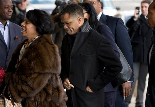 Former Illinois Rep. Jesse Jackson Jr. and his legal team arrives at the E. Barrett Prettyman Federal Courthouse in Washington, Wednesday, Feb. 20, 2013. (AP Photo/Evan Vucci)