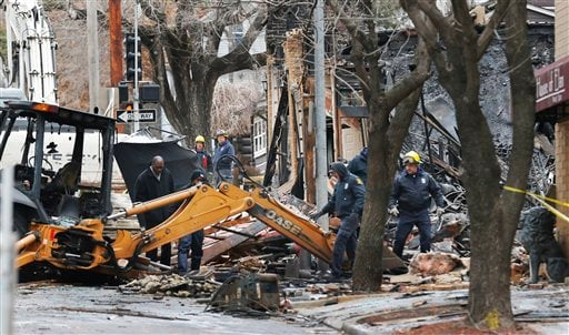 Officials inspect a burned out JJ's Restaurant at the Plaza shopping district of Kansas City, Mo., Wednesday, Feb. 20, 2013. (AP)