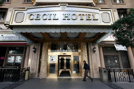 A visitor arrives at the hotel Cecil on Wednesday Feb. 20,2013 where police say the body of a woman was found wedged in one of the water tanks on the roof was that of a missing Canadian guest. (AP)