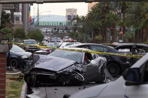 Police rope off the scene of a shooting and multi-car accident on the Las Vegas Strip in Las Vegas early Thursday, Feb. 21, 2013. (AP)