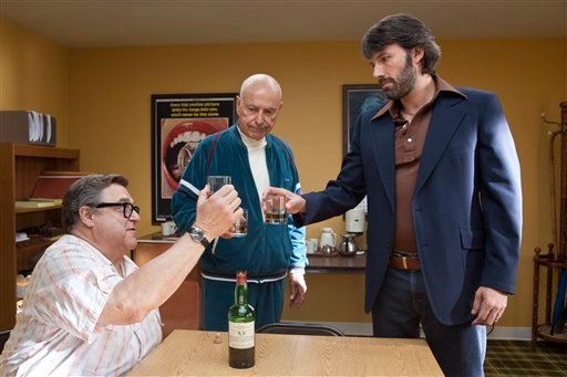 """This publicity image released by Warner Bros. Pictures shows John Goodman, left, Alan Arkin, center, and actor-director Ben Affleck in a scene from """"Argo."""" (AP Photo/Warner Bros. Pictures, Claire Folger, File)"""