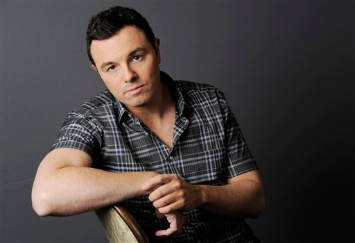 © This June 16, 2012 photo shows Seth MacFarlane posing for a portrait at The Four Seasons Hotel in Beverly Hills, Calif. Early reviews for Seth MacFarlane's Oscar-hosting skills are very positive.