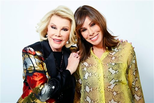 This Feb. 21, 2013 photo shows comedian Joan Rivers, left, and her daughter Melissa Rivers in New York. (AP)