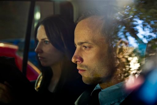 © Olympic athlete Oscar Pistorius, right, and his sister Aimee, left, are driven to a relatives home in Pretoria, South Africa, Friday, Feb. 22, 2013.