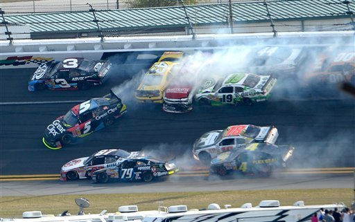 © Michael Annett (43), Johanna Long (70), Hal Martin (44), Mike Bliss (19), Jason White (00), Joe Nemechek (87), Jeffrey Earnhardt (79), Matt Kenseth (18), Danny Efland (4) and Kasey Kahne (5) collide and slide as Austin Dillon (3) escapes.