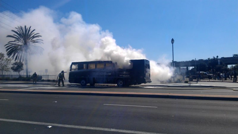 © Charter bus catches fire near the Old Town Trolley Station. Photo credit: Leon Segal.