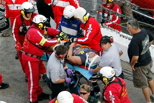 © An injured spectator is treated after a crash at the conclusion of the NASCAR Nationwide Series auto race Saturday, Feb. 23, 2013, at Daytona International Speedway in Daytona Beach, Fla.