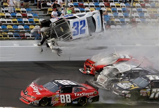  Kyle Larson (32) goes airborne and into the catch fence in a multi-car crash involving Dale Earnhardt Jr. (88), Parker Kligerman (77), Justin Allgaier (31) and Brian Scott (2) during the final lap of the NASCAR Nationwide Series auto race at Daytona.