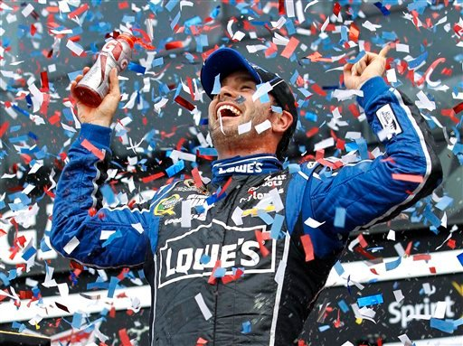 © Jimmie Johnson celebrates after winning the Daytona 500 NASCAR Sprint Cup Series auto race, Sunday, Feb. 24, 2013, at Daytona International Speedway in Daytona Beach, Fla. (AP Photo/Terry Renna)