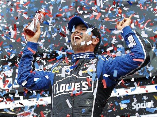© Jimmie Johnson celebrates after winning the Daytona 500 NASCAR Sprint Cup Series auto race, Sunday, Feb. 24, 2013, at Daytona International Speedway in Daytona Beach, Fla. (AP Photo/Terry Renna)
