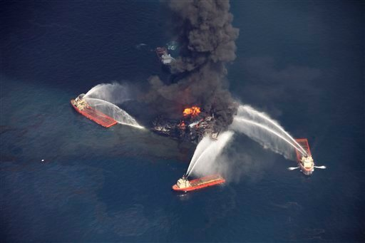 © In this aerial file photo madeWednesday, April 21, 2010 in the Gulf of Mexico, more than 50 miles southeast of Venice on Louisiana's tip, an oil slick is seen as the Deepwater Horizon oil rig burns.