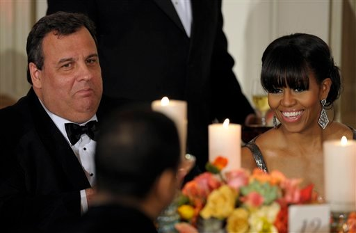  New Jersey Gov. Chris Christie sits next to first lady Michelle Obama as President Barack Obama welcomed the governors of the National Governors Association to the 2013 Governors Dinner at the White House in Washington, Sunday, Feb. 24, 2013.