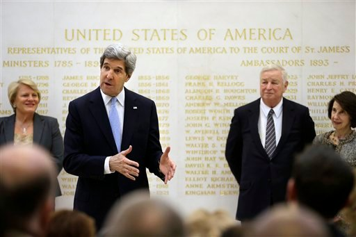 © U.S. Secretary of State John Kerry, second from left, speaks alongside U.S. Ambassador Louis Susman, third from left, during a visit to the U.S. Embassy, London, Monday, Feb. 25, 2013.