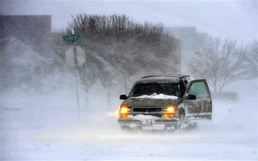 Traffic moves on the I-40 service road Monday, Feb. 25, 2013. A blizzard packing 50 mph wind gusts and more than 11 inches of snow blasted Amarillo and Texas Panhandle Monday, making travel nearly impossible. (AP)
