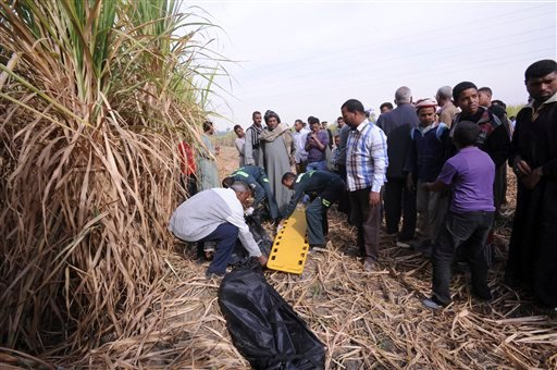 © Rescue workers remove a body from the scene of a balloon crash outside al-Dhabaa village, just west of the city of Luxor, 510 kilometers (320 miles) south of Cairo, Egypt, Tuesday, Feb. 26, 2013.