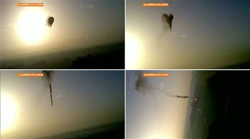 In this combo made from images from amateur video provided by Al-Jazeera, smoke pours from a hot air balloon over Luxor, Egypt, top left, before bursting, top right, and plummeting about 1,000 feet to earth. (AP)