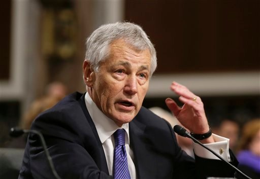 © In this Jan. 31, 2013, file photo, Secretary of Defense nominee Chuck Hagel testifies before the Senate Armed Services Committee during his confirmation hearing on Capitol Hill in Washington.