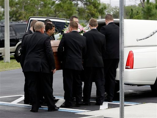 Pall bearers place the casket of country music star Mindy McCready into a hearse after a funeral ceremony at the Crossroads Baptist Church in Fort Myers, Fla., Tuesday, Feb. 26, 2013. (AP)
