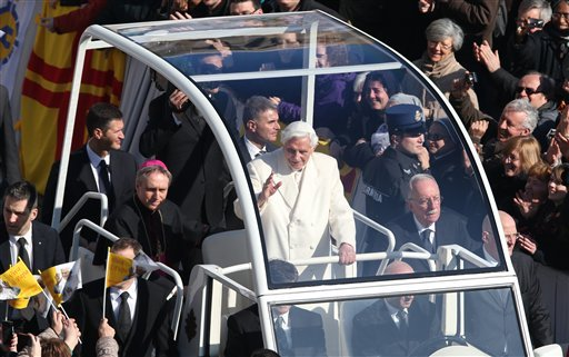 Pope Benedict XVI greets pilgrims in St. Peter's Square at the Vatican, Wednesday, Feb. 27, 2013 for the final time before retiring. (AP Photo/Luca Bruno)