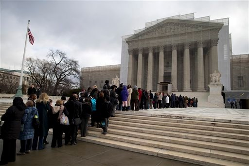People wait in line outside the Supreme Court in Washington, Wednesday, Feb. 27,2013, to listen to oral arguments in the Shelby County, Ala., v. Holder voting rights case. (AP Photo/Evan Vucci)