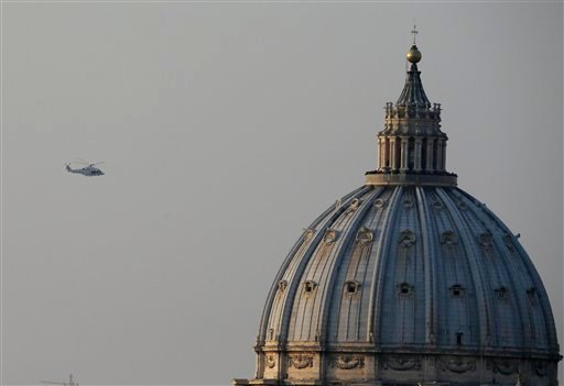 The helicopter taking Pope Benedict XVI to Castel Gandolfo leaves the Vatican in Rome, Thursday, Feb. 28, 2013.