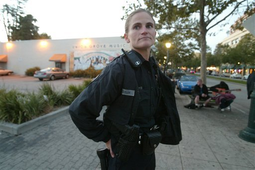 In this 2005 photo, Santa Cruz police officer Elizabeth Butler patrols along Pacific Avenue in Santa Cruz, Calif. (AP Photo/Santa Cruz Sentinel, Shmuel Thaler)