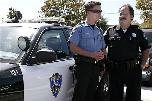 In this September 2010 photo, Santa Cruz police Sgt. Loran &quot;Butch&quot; Baker, right, stands with his son, Adam. (AP Photo/Santa Cruz Sentinel, Larissa Mueller)