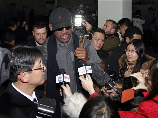 Flamboyant former NBA star Dennis Rodman is surrounded by journalists upon arrival at Pyongyang Airport, North Korea, Tuesday, Feb. 26, 2013. (AP Photo/Kim Kwang Hyon)