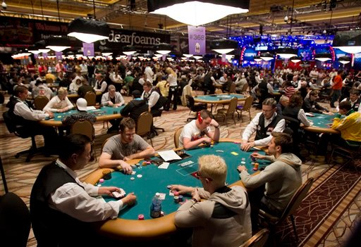 In this May 31, 2011 file photo, players compete in a Heads-Up poker tournament during the World Series of Poker at the Rio hotel and casino in Las Vegas. (AP Photo/Eric Jamison, File)