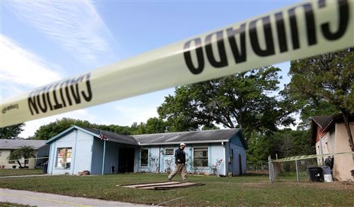 © An engineer surveys in front of a home where sinkhole opened up on Friday, March 1, 2013, in Seffner, Fla. A man screamed for help and disappeared as a large sinkhole opened under the bedroom of the house, his brother said Friday. (AP)