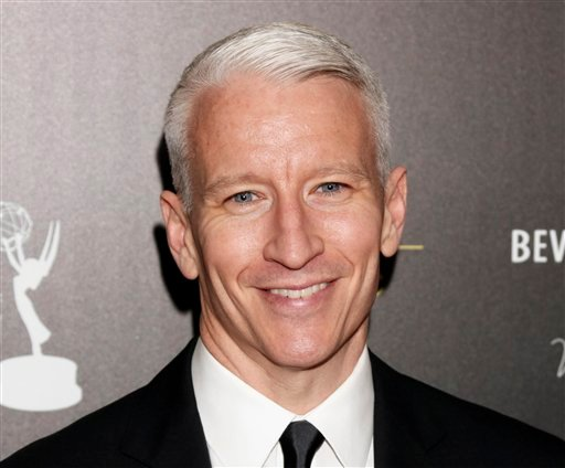 © This June 23, 2012 file photo shows CNN's Anderson Cooper arrives at the 39th Annual Daytime Emmy Awards at the Beverly Hilton Hotel in Beverly Hills, Calif.