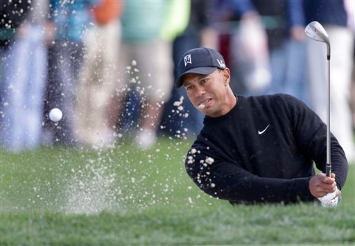 © Tiger Woods hits out of a bunker on the fourth hole during the third round of the Honda Classic golf tournament, Saturday, March 2, 2013 in Palm Beach Gardens, Fla. (AP Photo/Wilfredo Lee)