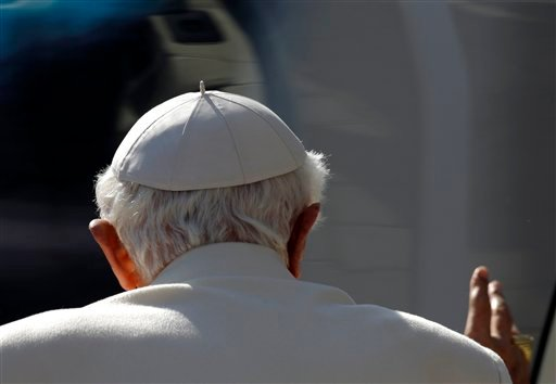 © Pope Benedict XVI greets pilgrims at the end of his general audience in St. Peter's Square at the Vatican, Wednesday, Feb. 27, 2013.