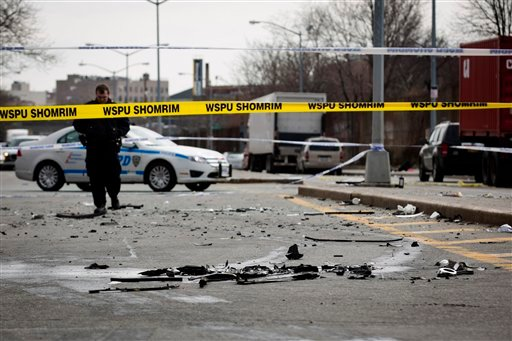 © Debris from a fatal accident that claimed the lives of two expectant parents litter Kent Avenue, Sunday, March 3, 2013, in the Brooklyn borough of New York.