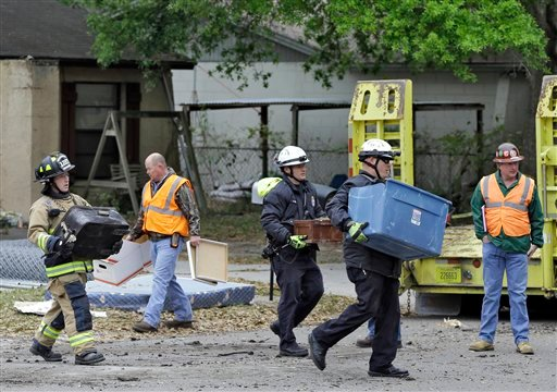 © Hillsborough County, Fla., firefighters remove salvaged items, from the home where a sinkhole swallowed Jeffrey Bush, late Thursday in Seffner, Fla., on Sunday, March 3, 2013.