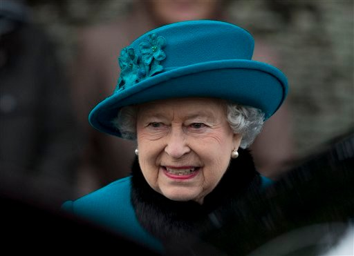 ©  A Tuesday, Dec. 25, 2012 photo from files showing Britain's Queen Elizabeth II as she walks to get in her car after attending the British royal family's traditional Christmas Day church service in Sandringham, England.
