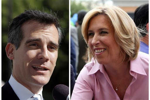 © This combo shows a Feb. 20, 2013 file photo of Los Angeles mayoral candidate Eric Garcetti speaking to media in Los Angeles, left, and undated image provided by the Wendy Greuel Campaign of mayoral candidate Greuel meeting with voters.