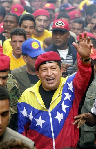 FILE - In this Jan. 23, 2002 file photo, Venezuela's President Hugo Chavez waves to supporters during a government march commemorating the anniversary of Venezuelan democracy in Caracas, Venezuela. (AP)