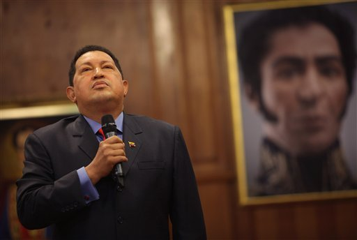FILE - In this Oct. 9, 2012 file photo, backdropped by a portrait of independence hero Simon Bolivar, Venezuela's President Hugo Chavez talks during a press conference at the Miraflores palace in Caracas, Venezuela. (AP)