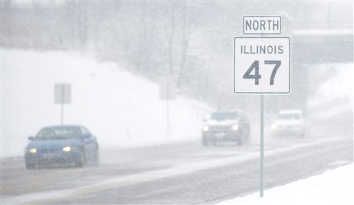 Visibility along Route 47 in the Chicago suburb of Lily Lake, Ill. is very limited as wet snow continues to fall during a snow storm on Tuesday, March 5, 2013. (AP Photo/Daily Herald, Laura Stoecker)