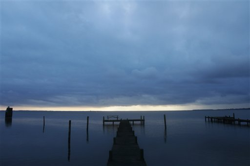Dark clouds spread over Currituck Sound as a winter storm approaches the Outer Banks of North Carolina on Wednesday, March 6, 2013. (AP Photo/The Virginian-Pilot, Steve Earley)