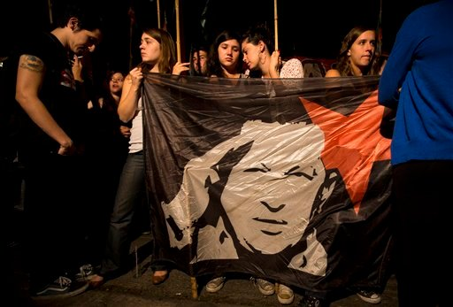Argentine supporters of Venezuela's President Hugo Chavez gather in front of Venezuela's embassy in Buenos Aires, Argentina, Tuesday, March 5, 2013. (AP Photo/Victor R. Caivano)